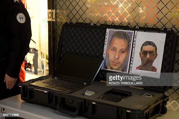 Picture taken on December 3, 2015 at the Roissy-Charles-de-Gaulle airport in Roissy-en-France, outside Paris shows the wanted notice of terrorist...