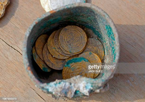 A picture taken on December 3 shows ancient gold coins recently uncovered at an excavation site in the Israeli Mediterranean town of Caesarea A...