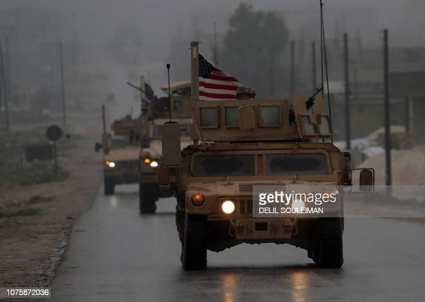 A picture taken on December 30 shows a line of US military vehicles in Syria's northern city of Manbij President Donald Trump announced last week...