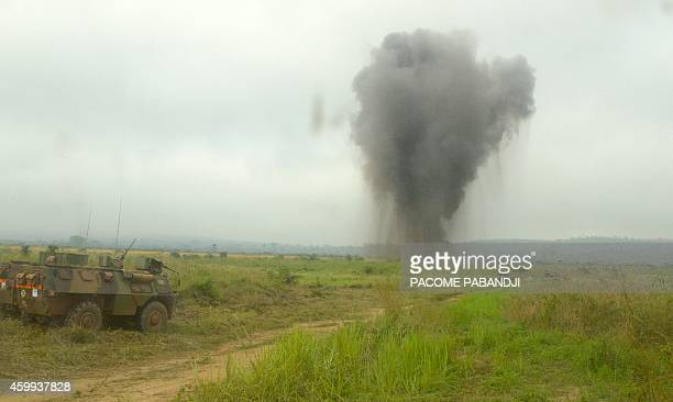 A picture taken on December 4 2014 in Bangui shows an explosion during a weapons destruction operation by the French soldiers of the Sangaris The...