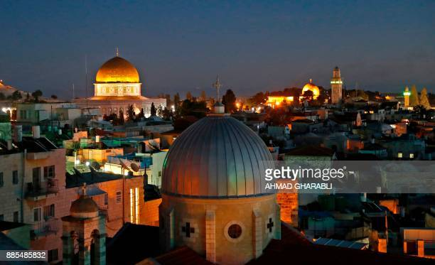 A picture taken on December 4 2017 shows a general view of the skyline of the old city of Jerusalem with the Dome of the Rock in the Aqsa Compund...