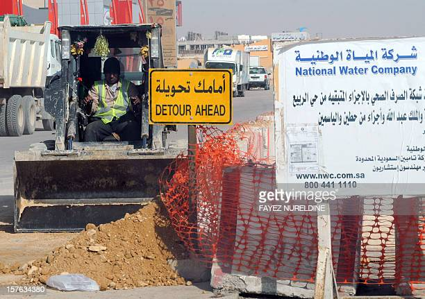 A picture taken on December 4 shows a Asian laborer of the Saudi National Water Company working at a construction site in a main road in the capital...