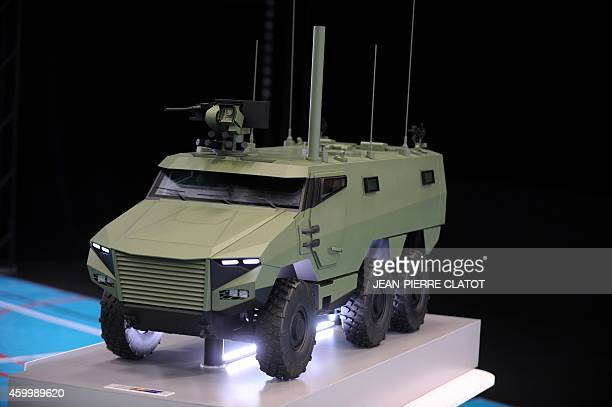 A picture taken on December 5 2014 at the military base of Varces eastern central France shows a miniature model of the armoured reconnaissance and...