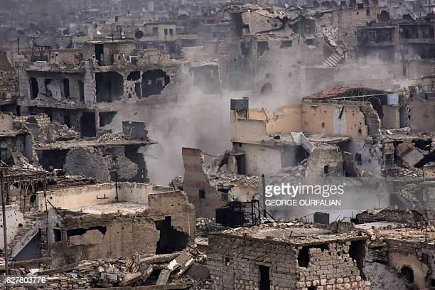 CORRECTION A picture taken on December 5 2016 shows destroyed buildings in Aleppo's eastern alShaar neighbourhood as Syrian progovernment troops...