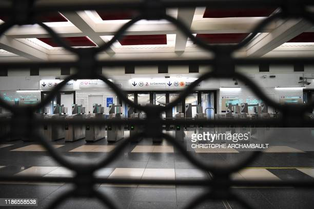 TOPSHOT A picture taken on December 5 2019 shows a closed metro station during a strike of Paris public transports operator RATP and state railway...