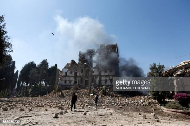 TOPSHOT A picture taken on December 5 shows the damage after a reported air strike carried out by the Saudiled coalition targeted the presidential...