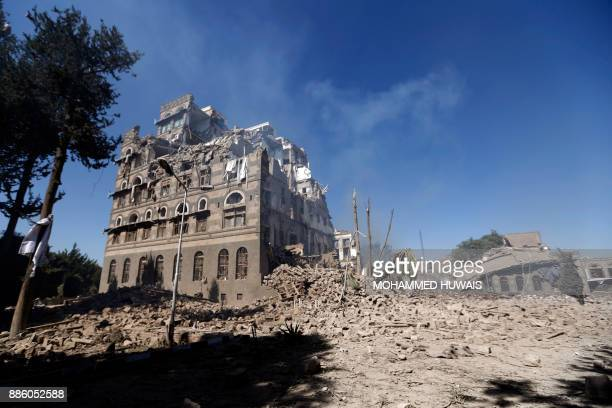 A picture taken on December 5 shows the damage after a reported air strike carried out by the Saudiled coalition targeted the presidential palace in...