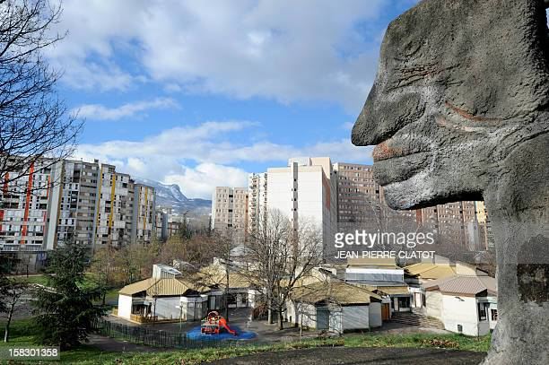 A picture taken on December 6 2012 shows a kindergaten among tall buildings in the Villeneuve quarter of Grenoble southeastern France This area is at...