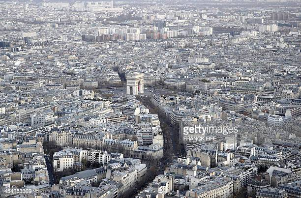 A picture taken on December 6 2013 shows the Arc de Triomphe and buildings in Paris AFP PHOTO / FRANCK FIFE