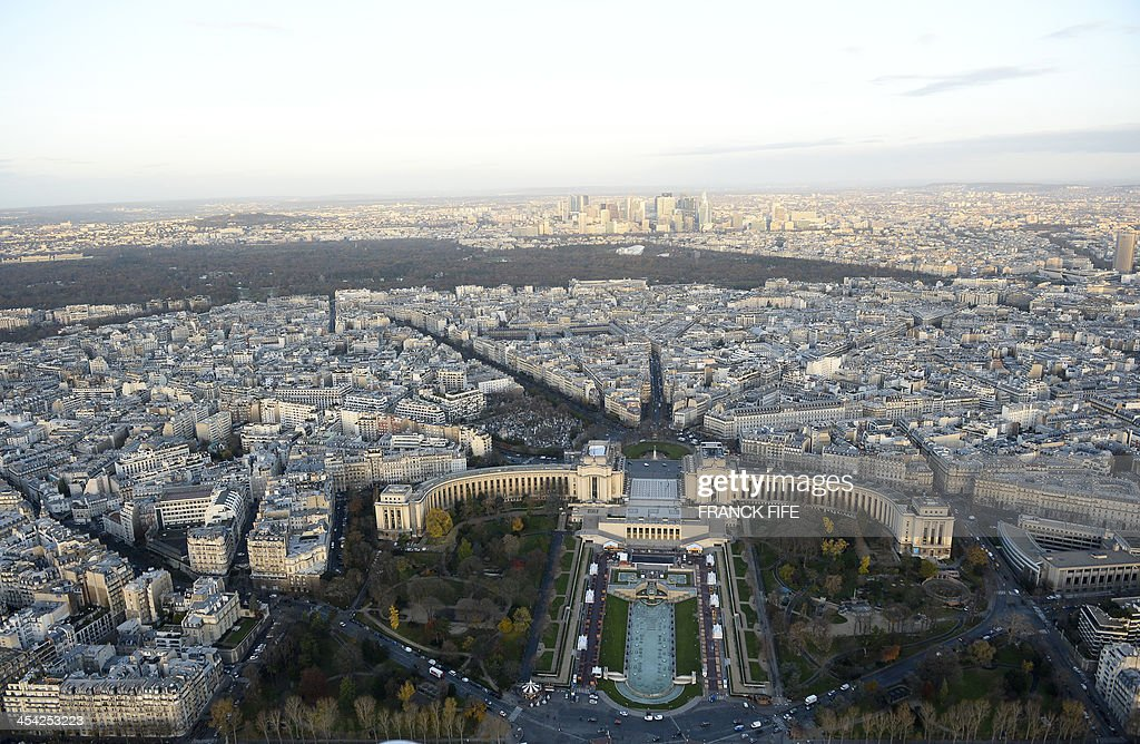 A picture taken on December 6, 2013 shows the Trocadero and its gardens (foreground), the Bois de Boulogne and the business district of La Defense (background) in Paris.