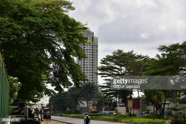 A picture taken on December 6 2016 shows people on a street in Cocody a high class northern urban commune of Abidjan Two thousand trees planted in...