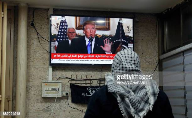 A picture taken on December 6 2017 shows a Palestinian man watching an address given by US President Donald Trump at a cafe in Jerusalem US President...