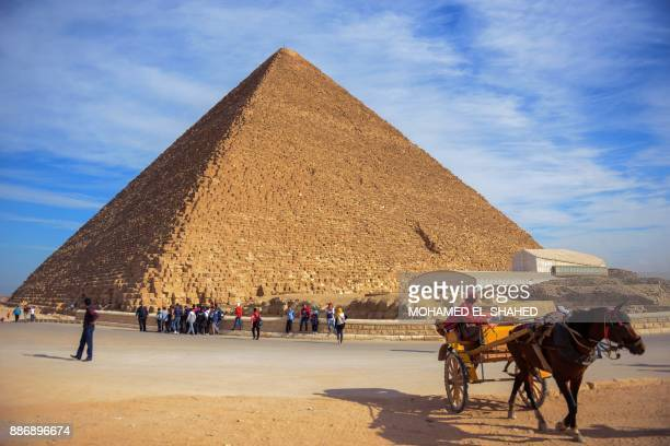 A picture taken on December 6 2017 shows a view of the Great Pyramid of Khufu on the Giza Plateau on the southwestern outskirts of the capital Cairo...