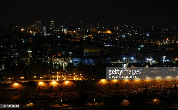 TOPSHOT A picture taken on December 6 2017 shows a view of the old city of Jerusalem from the Mount of the Olives after the Palestinian Ministry for...