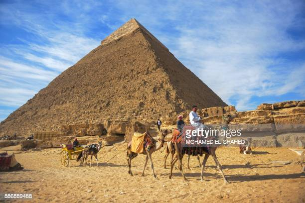 A picture taken on December 6 2017 shows a view of the pyramid of Khafre on the Giza Plateau on the southwestern outskirts of the capital Cairo / AFP...