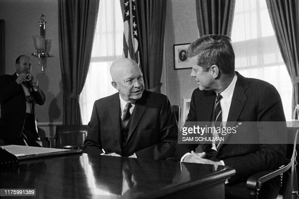 Picture taken on December 7, 1960 at Washington showing a meeting between the new American President John F. Kennedy and his predecessor Dwight D....