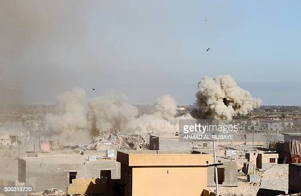A picture taken on December 7 2015 shows smoke billowing in the rural town of Husayba in the Euphrates Valley seven kilometres east of Ramadi where...
