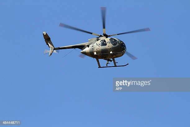 A picture taken on December 8 2013 shows a Kenyan military helicopter hovering over the restive town of Moyale in Marsabit county on Kenya's frontier...