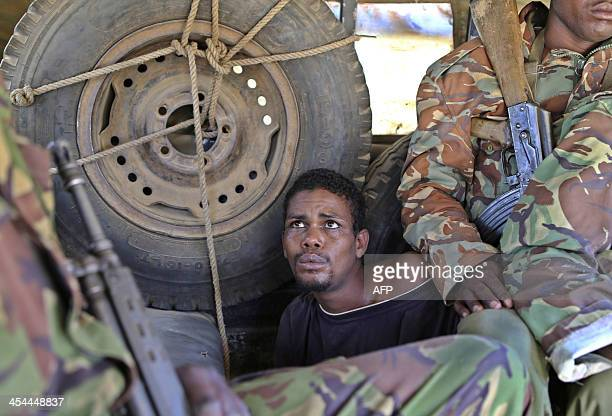 A picture taken on December 8 2013 shows a suspected clan militia fighter arrested by Kenyan forces during a security operation in the restive town...
