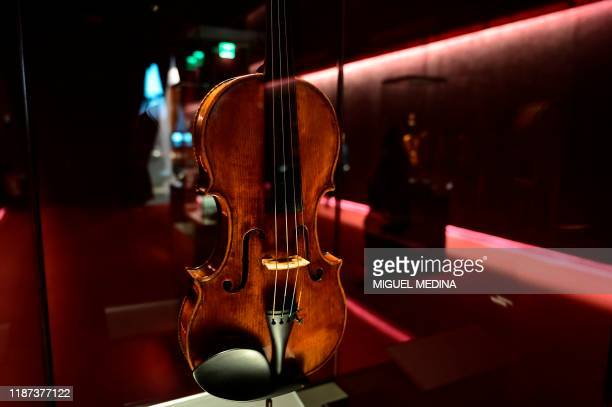 A picture taken on December 8 2019 shows a Stradivarius violin at the the Violin museum in Cremona The museum is best known for its collection of...