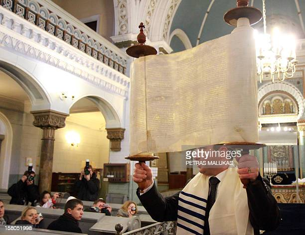 STORY Picture taken on December 9 2012 shows Simon Gurevich Executive Director of the Lithuanian Jewish community giving a service attended by...