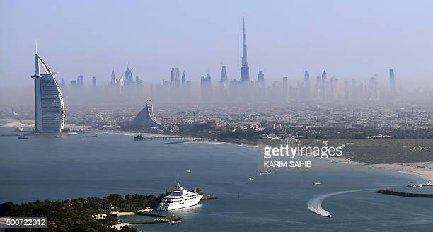 A picture taken on December 9 2015 shows a general view of Burj Khalifa the world's tallest tower and luxury Burj alArab Hotel in Dubai AFP PHOTO /...