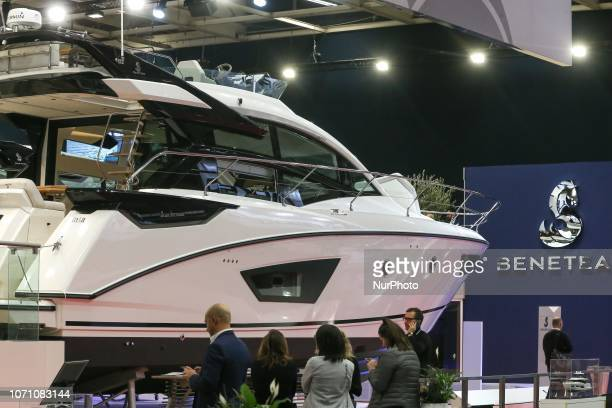 A picture taken on December 9 2018 shows a motorboat of the French yacht manufacturer Beneteau on display during the Paris International Boat Show at...