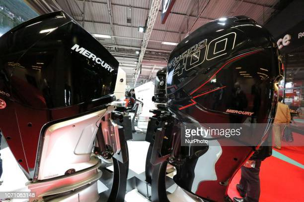 A picture taken on December 9 2018 shows boat motors of the manufacturer Mercury on display during the Paris International Boat Show at the Porte de...