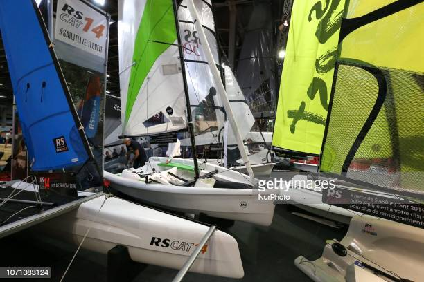A picture taken on December 9 2018 shows sailing boats of the English sailboats and dinghies manufacturer RS Sailing on display during the Paris...