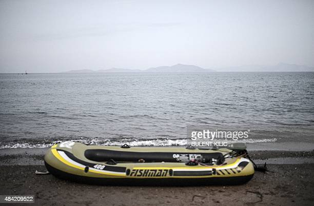 A picture taken on earl yAugust 16 2015 shows an empty boat left by migrants off the shore of Bodrum southwest Turkey Authorities on the island of...