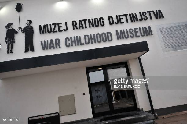 A picture taken on February 1 2017 shows the main entrance of the Sarajevo's newly opened War Childhood Museum Ballet slippers tinned food and...