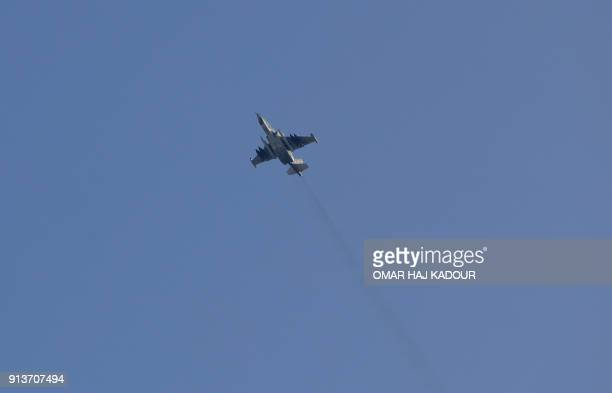 A picture taken on February 1 shows a Sukhoi25 fighter jet flying over the Syrian city of Saraqib southwest of Aleppo Rebel fighters shot down a...