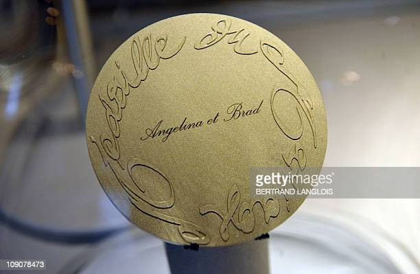 A picture taken on February 10 2011 at Paris Hotel des Monnaies shows a marriage medal designed by French fashion designer and creative director of...