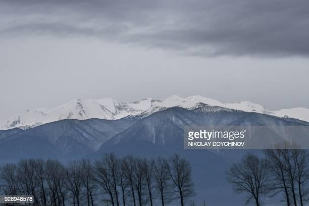 "Picture taken on February 10, 2017 shows the Pirin mountain near Bansko. ""Unlimited Ski&Fun!"" promises a pamphlet touting the Bansko ski resort, a..."