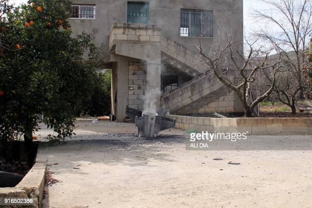 A picture taken on February 10 shows the remains of a missile that landed in the southern Lebanese village of Kaoukaba near the border with Syria...