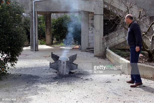TOPSHOT A picture taken on February 10 shows the remains of a missile that landed in the southern Lebanese village of Kaoukaba near the border with...