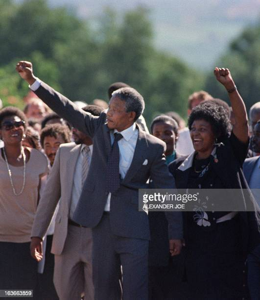 A picture taken on February 11 1990 shows Nelson Mandela and his thenwife antiapartheid campaigner Winnie raising their fists and saluting cheering...