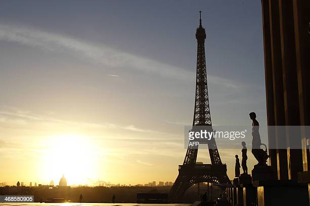 A picture taken on February 11 2014 at sunrise shows the Trocadero Esplanade also known as the Parvis des droits de l'homme in front of the Eiffel...