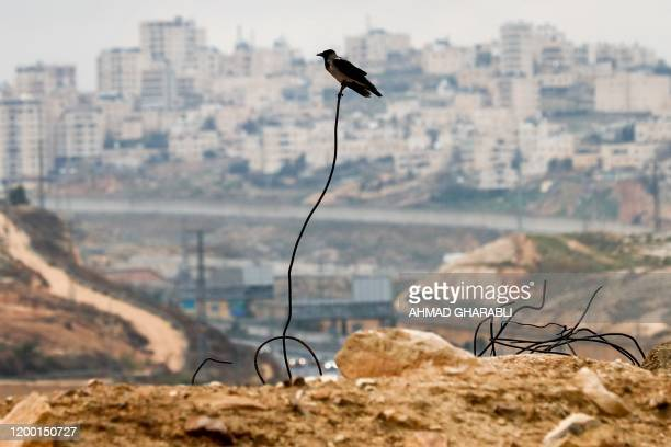 Picture taken on February 11, 2020 shows the Palestinian Shuafat refugee camp in east Jerusalem behind the controversial Israeli separation wall.