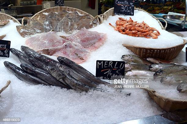 A picture taken on February 13 2014 in Bordeaux western France shows hakes rays prawns and soles at a fish shop High tides and winter storms not only...