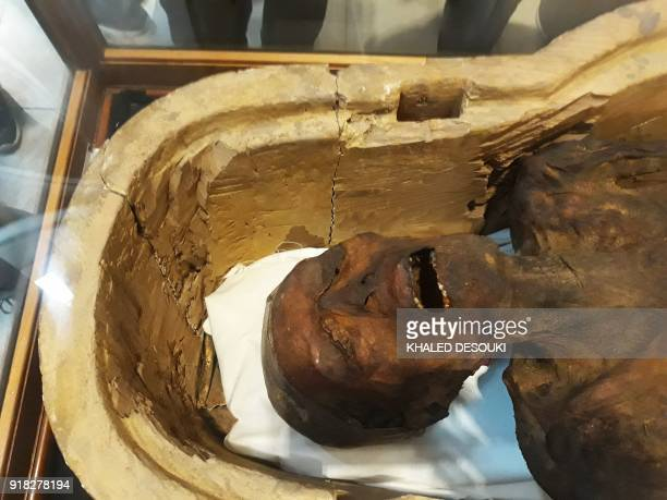 A picture taken on February 14 2018 shows the Screaming Mummy known scientifically as the unknown man E on display at the Egyptian Museum in Cairo's...