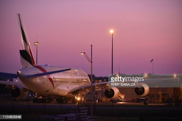 TOPSHOT A picture taken on February 14 2019 in Toulouse shows an Emirates' airline Airbus A380 parked in front of Airbus plant as European aerospace...