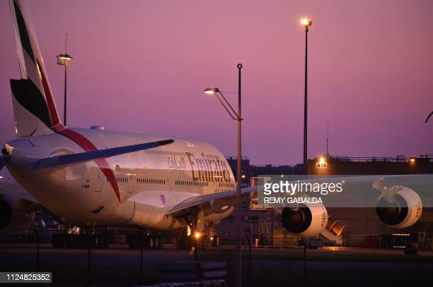 A picture taken on February 14 2019 in Toulouse shows an Emirates' airline Airbus A380 parked in front of Airbus plant as European aerospace giant...