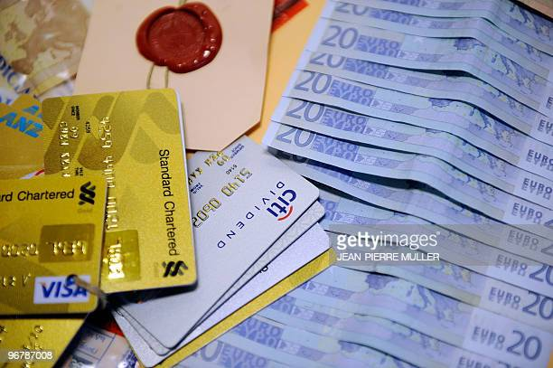 A picture taken on February 15 2010 in Bordeaux shows counterfeit 20euro banknotes and credit cards seized by French police in Toulouse Policemen...