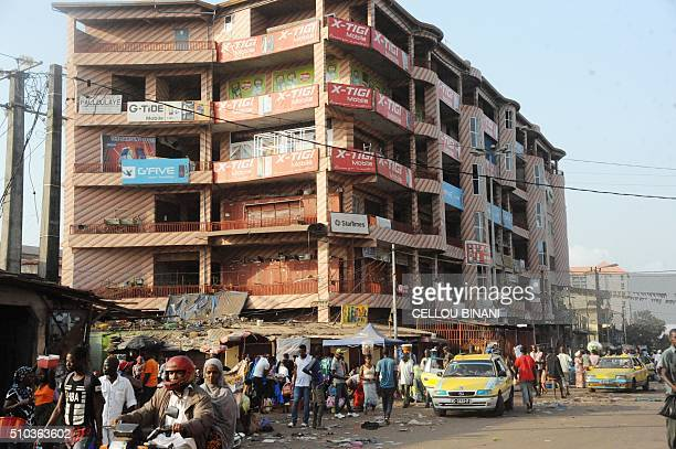 A picture taken on February 15 2016 shows people walking in a street of Conakry on February 15 on the day of a nationwide general strike in Guinea...