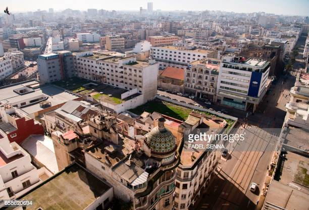 A picture taken on February 15 2016 shows the rooftops of old buldings in central Casablanca where poor locals have built shanty homes These squats...