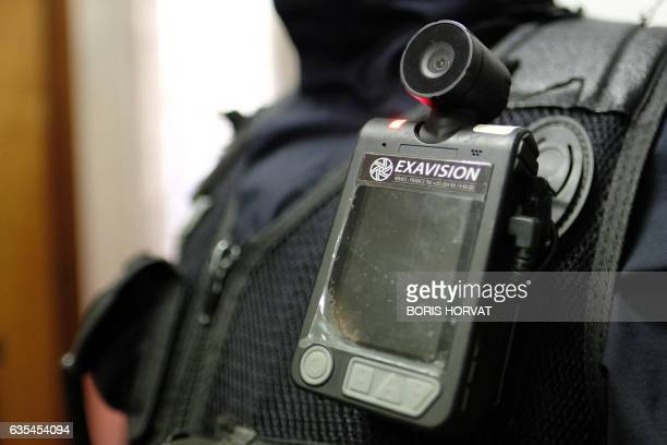 Picture taken on February 15, 2017 shows a body camera attached to the shoulder of a police officer, in Marseille. - Currently in Marseille, only the...