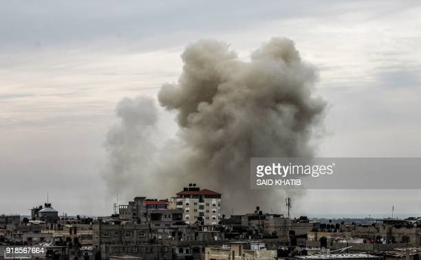 TOPSHOT A picture taken on February 15 2018 from the western Gaza strip border town of Rafah in shows a smoke plume rising on the Egyptian side of...