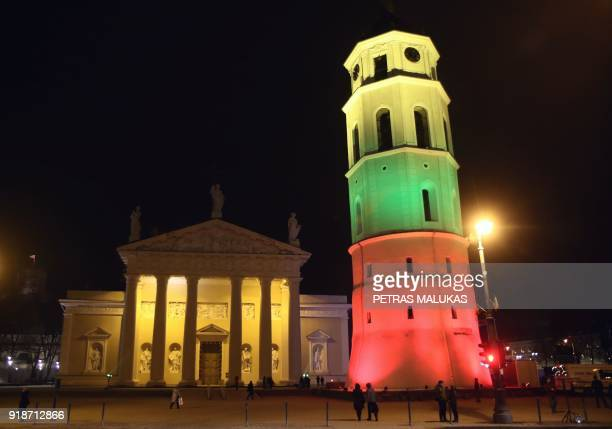 A picture taken on February 15 2018 in Vilnius shows a light installation with the national colours on a tower as part of the festivities marking 100...