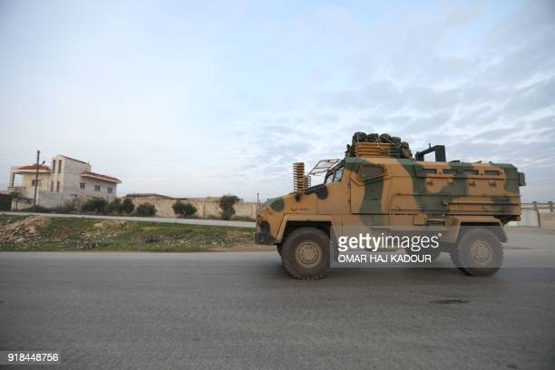 A picture taken on February 15 2018 shows a military vehicle from a Turkish military convoy driving through Syria's northwestern Idlib province KADOUR